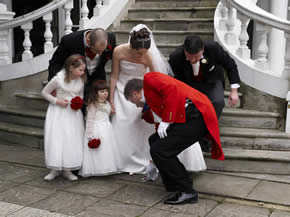 Englisg toastmaster Richard Palmer assisting Essex wedding photographer outside The Manor of Groves, Hertfordshire